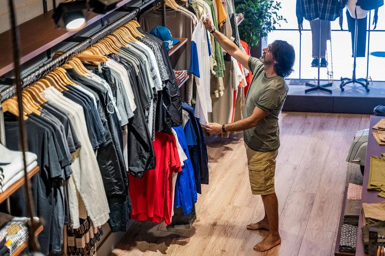 Full length of man standing in rack