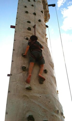 Taught my brother how to rock climb and he finally was able to do it by himself. Live To Learn Rock Wall Peach Festival Nevergiveup Keepgoingnomatterwhat Dontlookback
