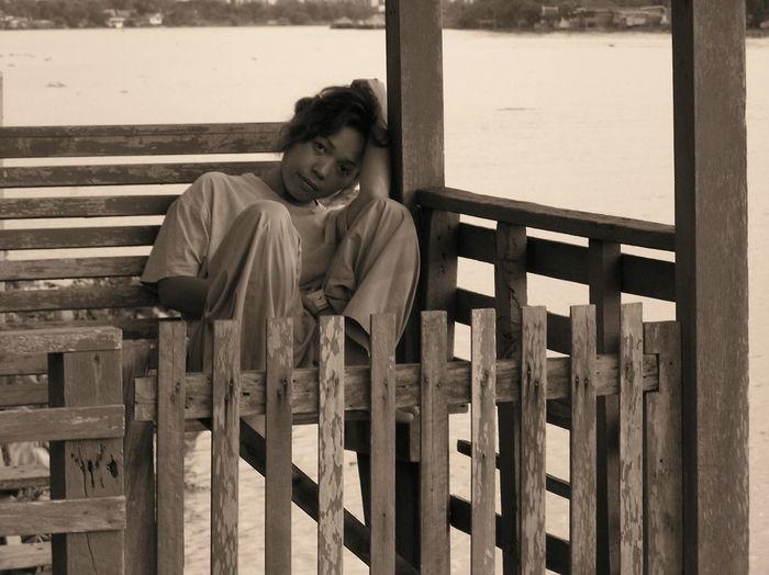 Portrait of teenage girl sitting on bench