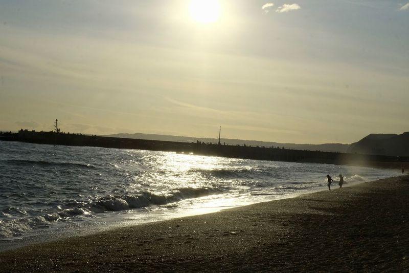 Beach Beauty In Nature Incidental People Land Real People Scenics - Nature Sea Sky Sun Sunlight Water