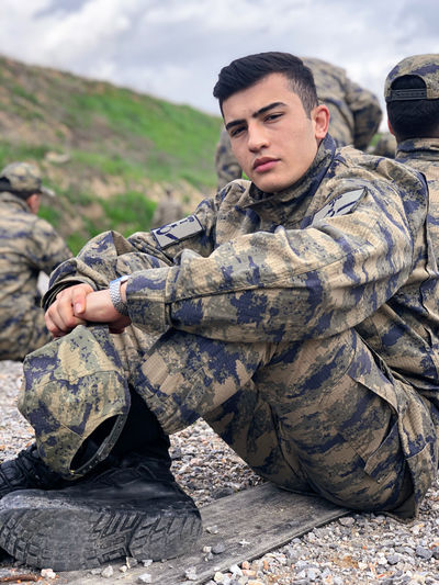 Portrait of army soldier sitting outdoors