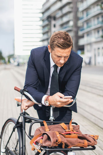 Midsection of man with bicycle