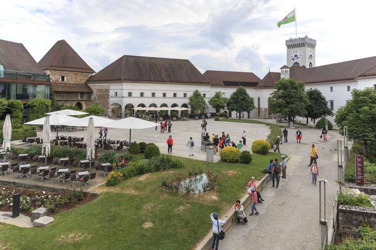 Ljubljana, Slovenia - June 6, 2017: View of the square inside the castle of Ljubljana and several tourists passing by Architecture Building Exterior Built Structure Church Cloud - Sky Cottage Day Europe Grass Lake Lake Bled Lake Bohinj Large Group Of People Men Nature Outdoors People Real People Sky Slovenia Tourists Tree Velika Planina Women