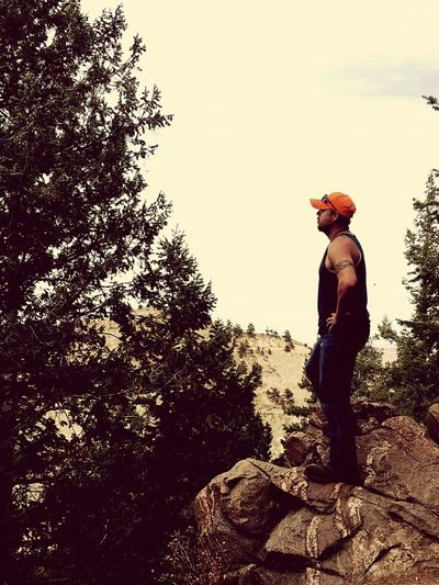 A friend of mine looking out over the valley. One Person Casual Clothing Tree Nature Leisure Activity Standing Outdoors Day Real People Beauty In Nature Sky Adult Autumn Lookout Mountain Denver,CO Rocks Mountain