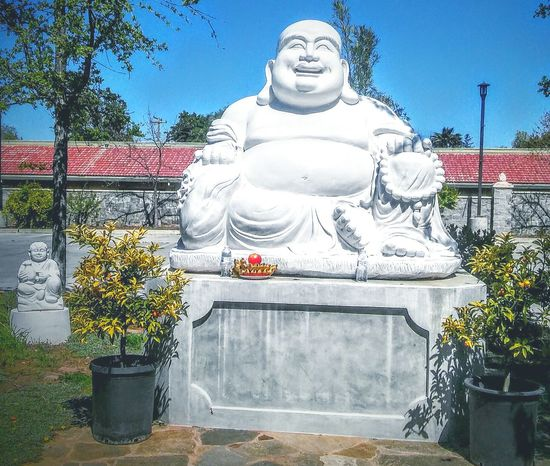 Buddhist Temple Enjoying Life This Week On Eyeem Meditation Garden Statues Harmony With Nature Stone - Object Meditation Buddist Temple Urban Spring Fever EyeEm Best Shots - Nature Leaves🌿 EyeEm Nature Lover Shades Of Green  Shades Of Nature Orange Tree Offerings Buddhas Big Belly :)