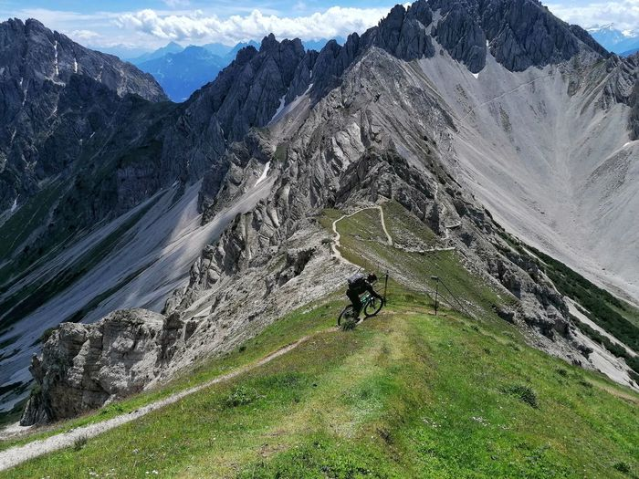 Woman riding the bike on mountain range