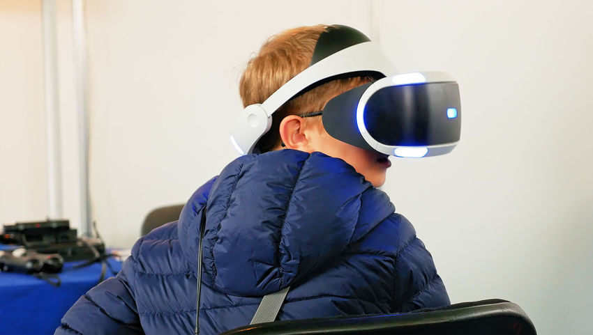Virtual Virtual Reality Simulator Virtual Reality VirtualReality Boys Childhood Day Indoors  Men Real People Rear View Sitting Technology Virtual Reality Headset Virtual Reality World Virtuality