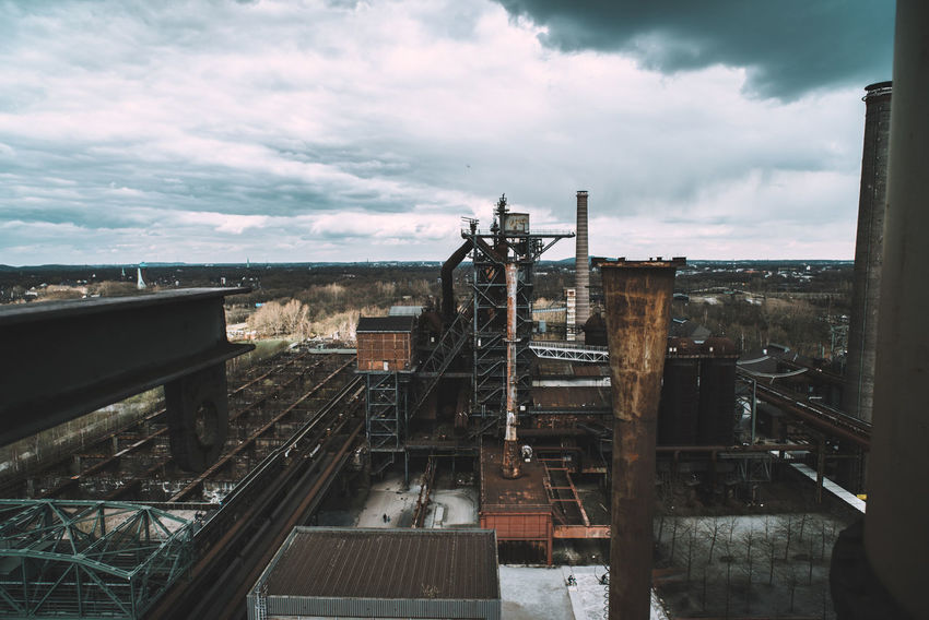 Landschaftspark Nord Architecture Building Exterior Built Structure Business Cloud - Sky Day Factory High Angle View Industry Nature No People Outdoors Pollution Rail Transportation Railroad Track Sky Smoke Stack Track Train Train - Vehicle Transportation