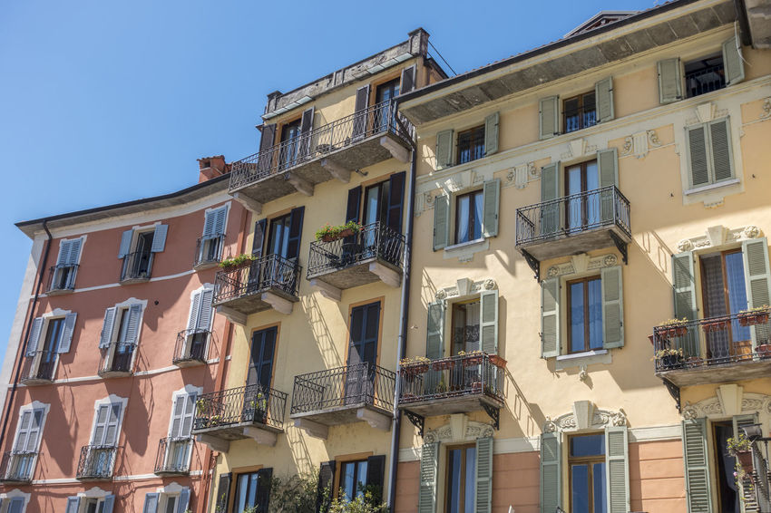 Facade of traditional buildings in Intra, Verbania, Italy Intra Lago Maggiore, Italy Verbania Italy Apartment Architecture Balcony Building Exterior Built Structure City Clear Sky Day Italy Low Angle View No People Outdoors Residential Building Sky Window