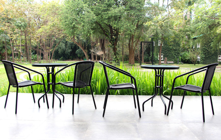 Chairs and tables in the corner of relax and nature in the morning in Thailand Floor Trees View Thailand Relax Rurelexploration Travel Relaxation Wood Happiness Guest Room Parlour Nature Helathcare Morning Holiday Home Beautiful Abundant Tree Table Chair Green Color Outdoors Day No People Park - Man Made Space Water Nature Sky