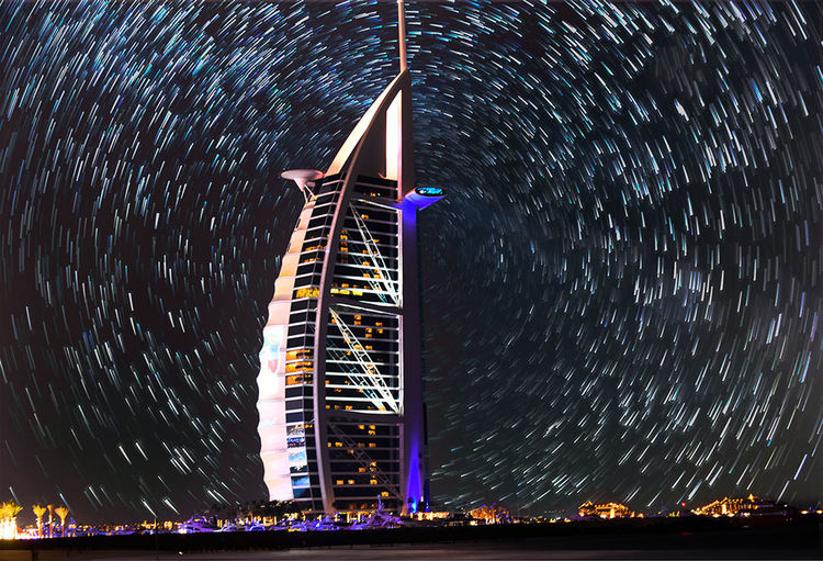 startrails behaind burj al arab Burj Al Arab DXB Dubai UAE United Arab Emirates Architecture Astronomy Blurred Motion Building Building Exterior Built Structure City Illuminated Light Trail Long Exposure Low Angle View Modern Motion Mydubai Nature Night No People Office Building Exterior Outdoors Sky Skyscraper Space Star - Space Star Trail Startrails Tall - High Tower