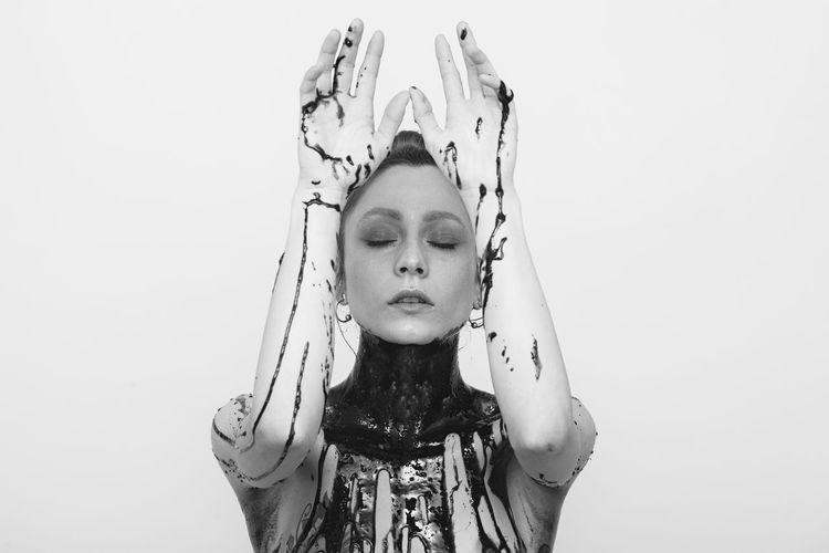 i'm on ig @riccardonosvelli Abstract White Background Portrait Model Blackandwhite Filmphotography Modern Young Women Headshot Beautiful Woman Human Face Studio Shot Beauty Individuality Body Paint
