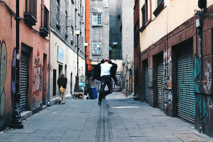 No one's first and you're next. Dramatic Jump Jumpshot Barrio Chino Mexico City Abduction Feel Alley The Portraitist - 2016 EyeEm Awards The Street Photographer - 2016 EyeEm Awards