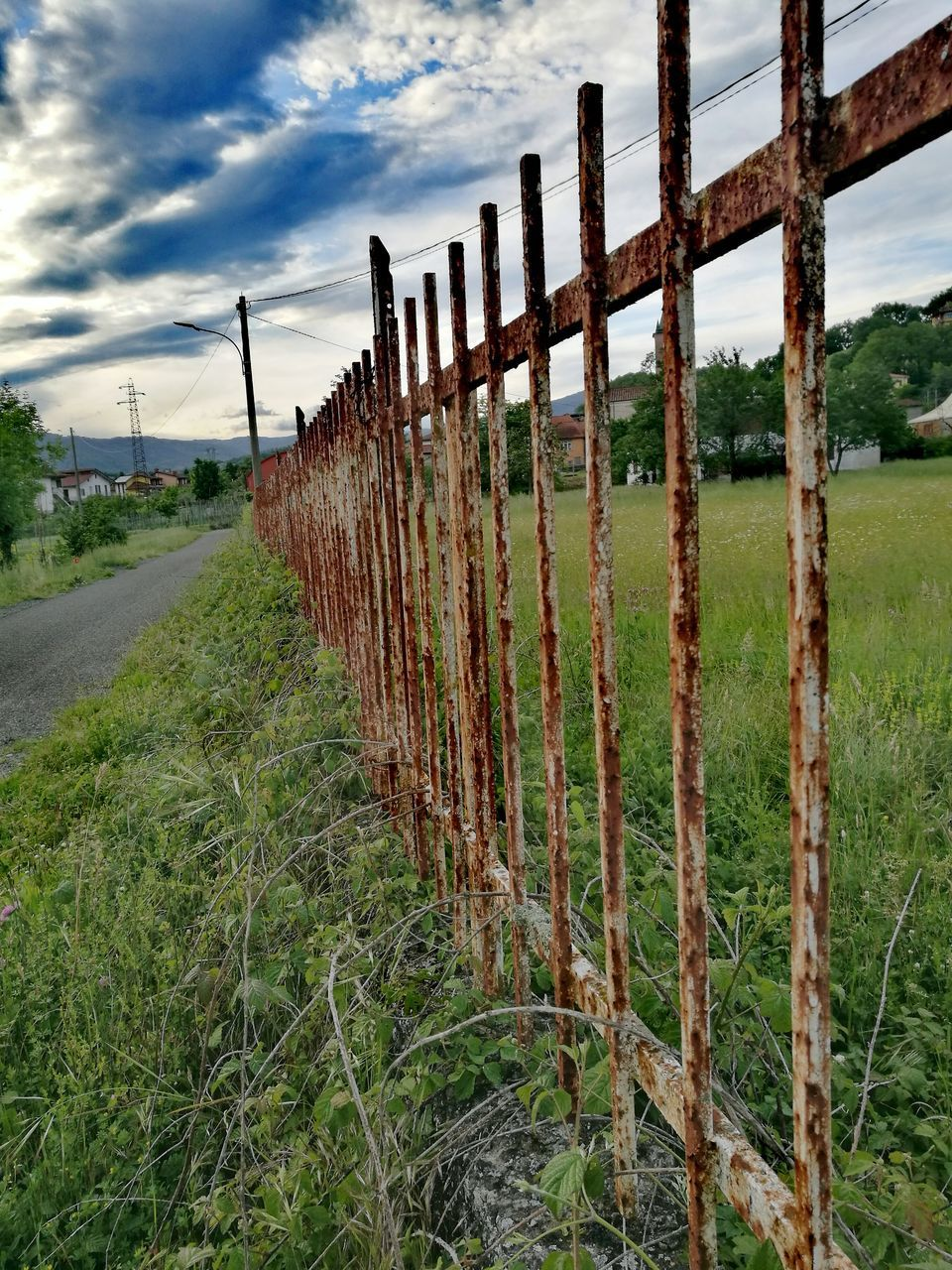 sky, grass, field, safety, cloud - sky, no people, day, barbed wire, outdoors, rural scene, wooden post, nature, growth