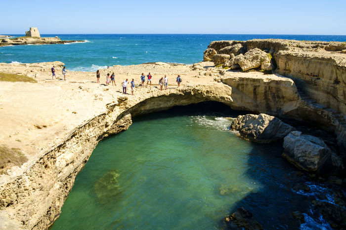 Beach Beauty In Nature Blue Day Grotta Della Poesia Horizon Over Water Italy Large Group Of People Lecce Leisure Activity Lifestyles Melendugno Nature Outdoors Puglia Real People Rock - Object Salento Salento, Italy Scenics Sea Sky Travel Destinations Vacations Water