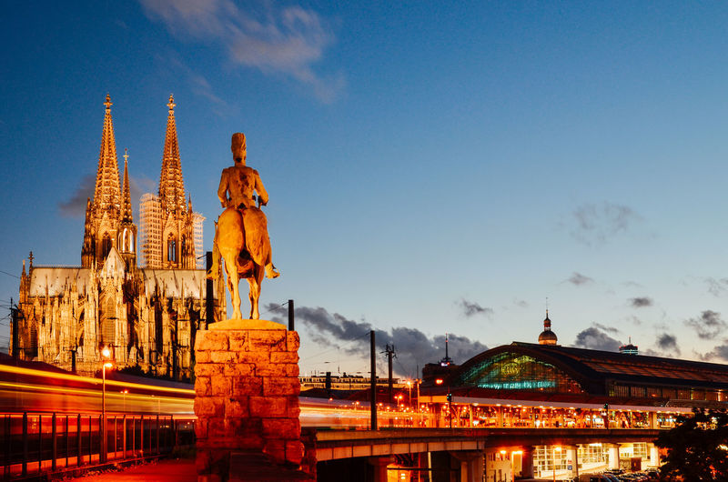 Cologne Cathedral And Emperor William Monument Against Sky