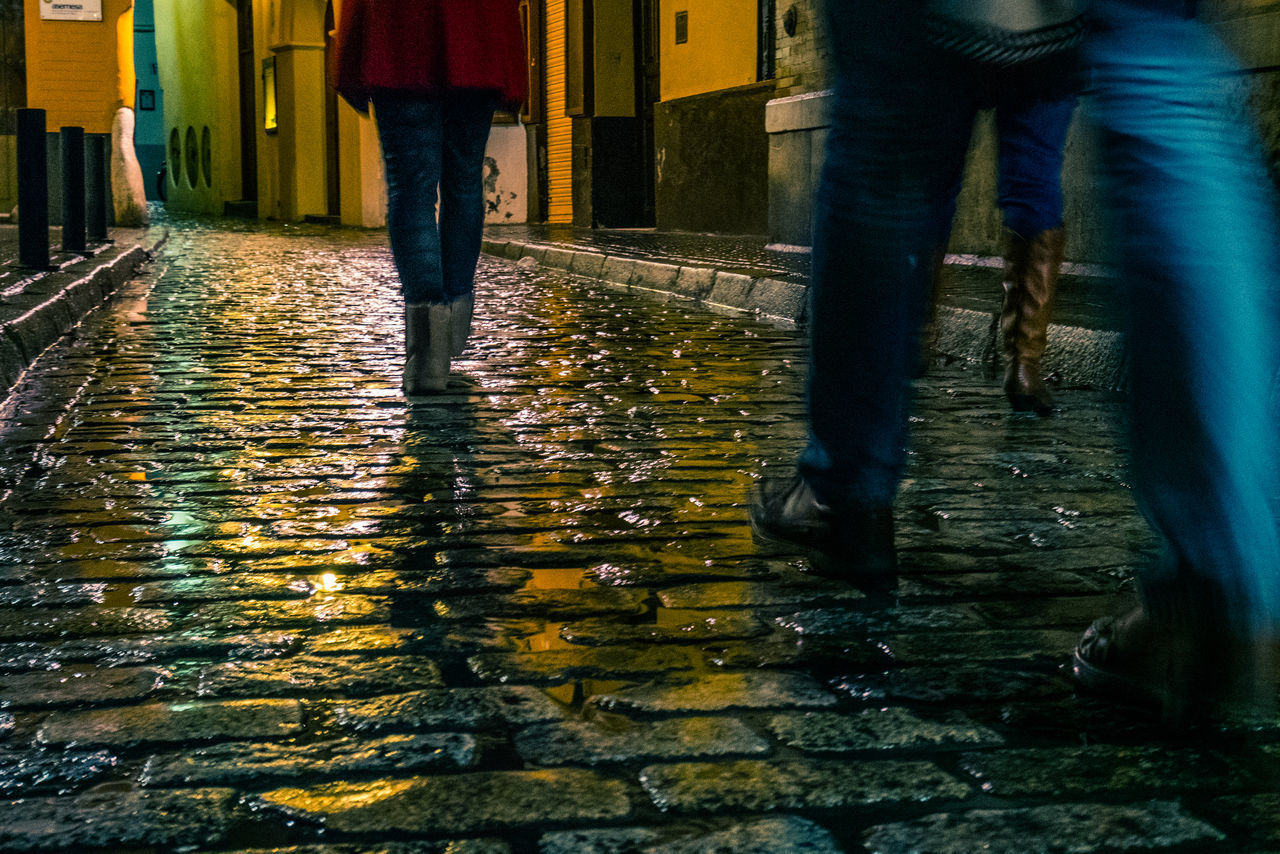low section, water, human leg, real people, body part, wet, human body part, lifestyles, nature, street, motion, rain, city, people, walking, architecture, outdoors, standing, rainy season, human foot, flowing water