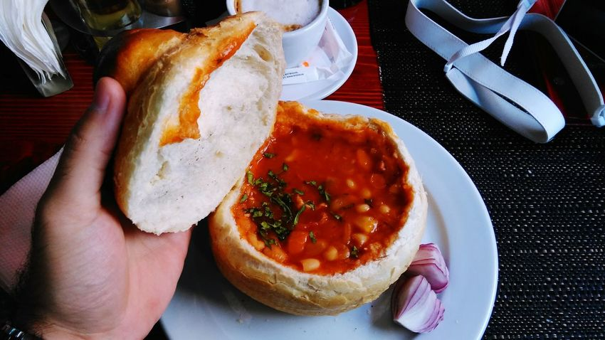 Bean stew with smoked bacon and red onion in a bread bowl Food Porn Awards