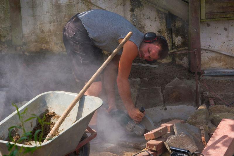 Man sawing tiles