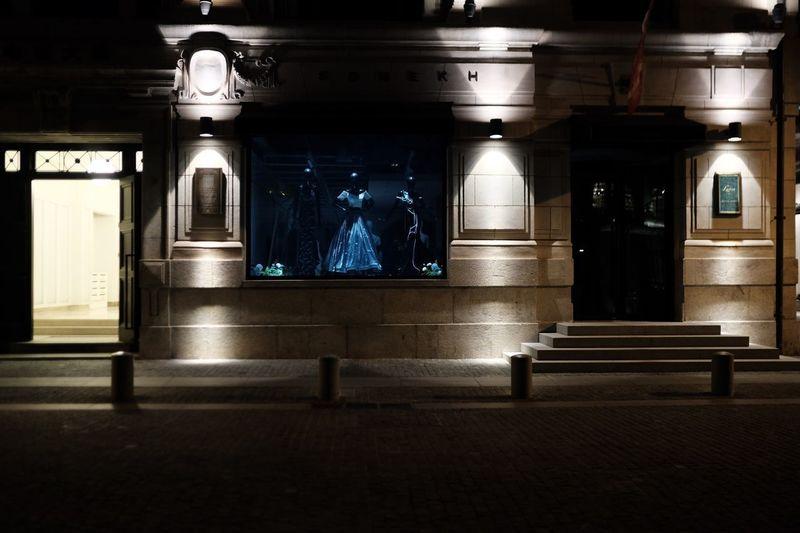 Illuminated railroad station in city at night