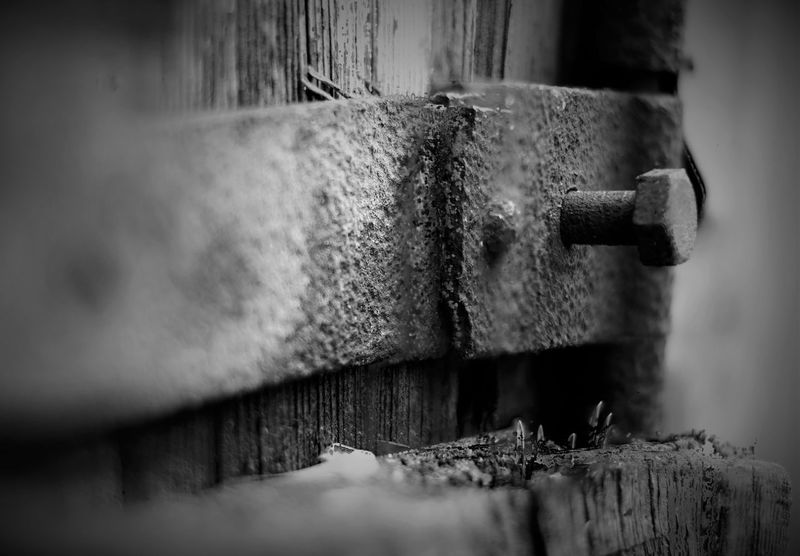 Close-up Focus On Foreground Metal Nikon Nikon 50mm F/1.8 Nikon D3100 Old Part Of Selective Focus Wall Wall - Building Feature Black And White Stacked Up Close Street Photography Urbanphotography Decay