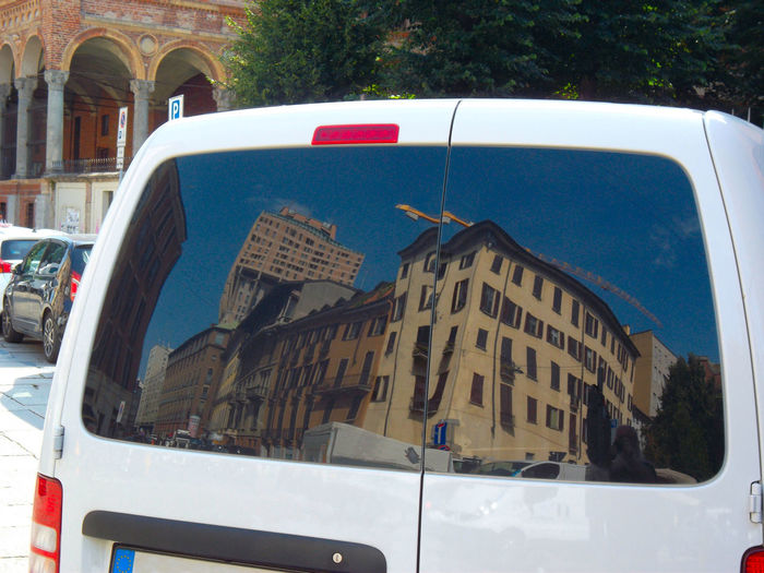 Walking around. Milano Reflection Through The Looking-Glass Car Close-up Day Land Vehicle Mode Of Transport No People Outdoors Reflection_collection Stationary Torre Velasca Transportation Università Statale Vehicle Windshield
