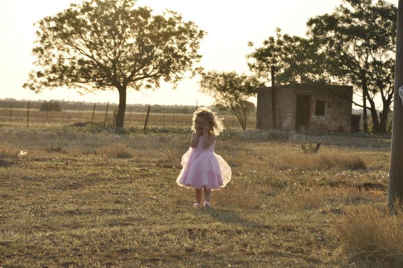 Girl standing in abandoned garden