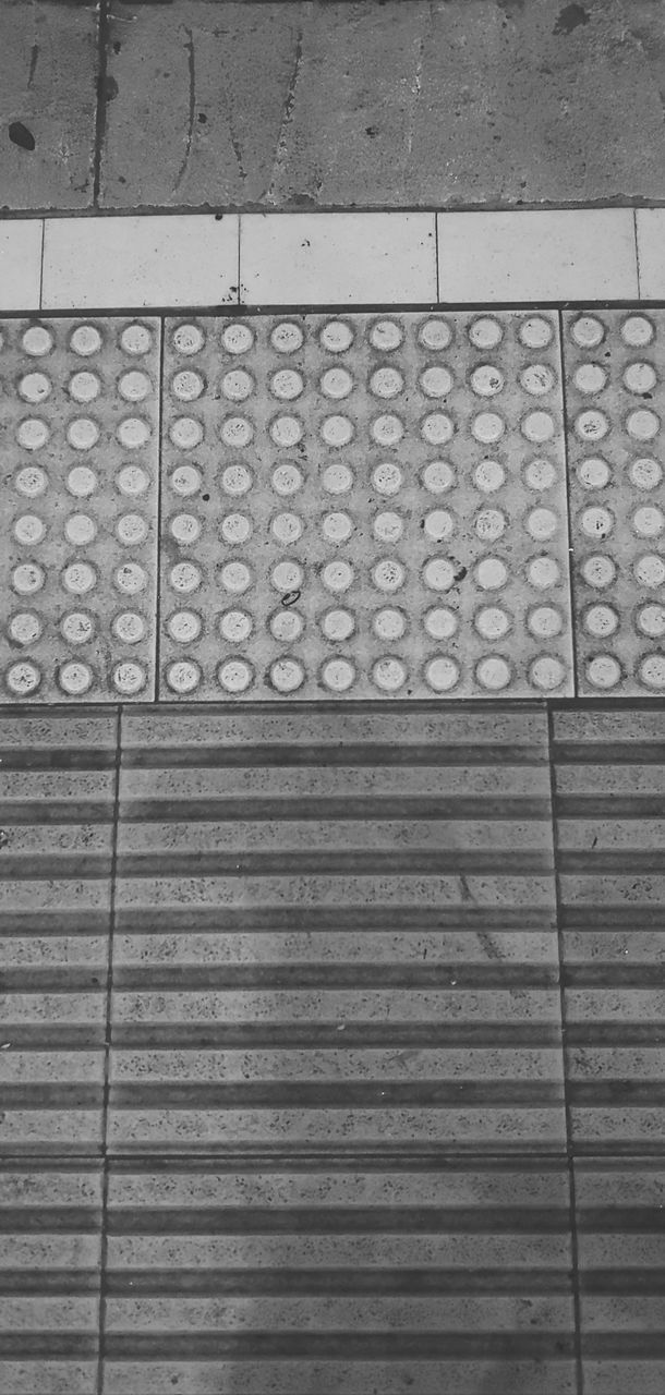 pattern, no people, high angle view, backgrounds, footpath, day, full frame, design, shape, outdoors, geometric shape, metal, flooring, textured, sunlight, built structure, safety, architecture, directly above, tile, paving stone, tiled floor