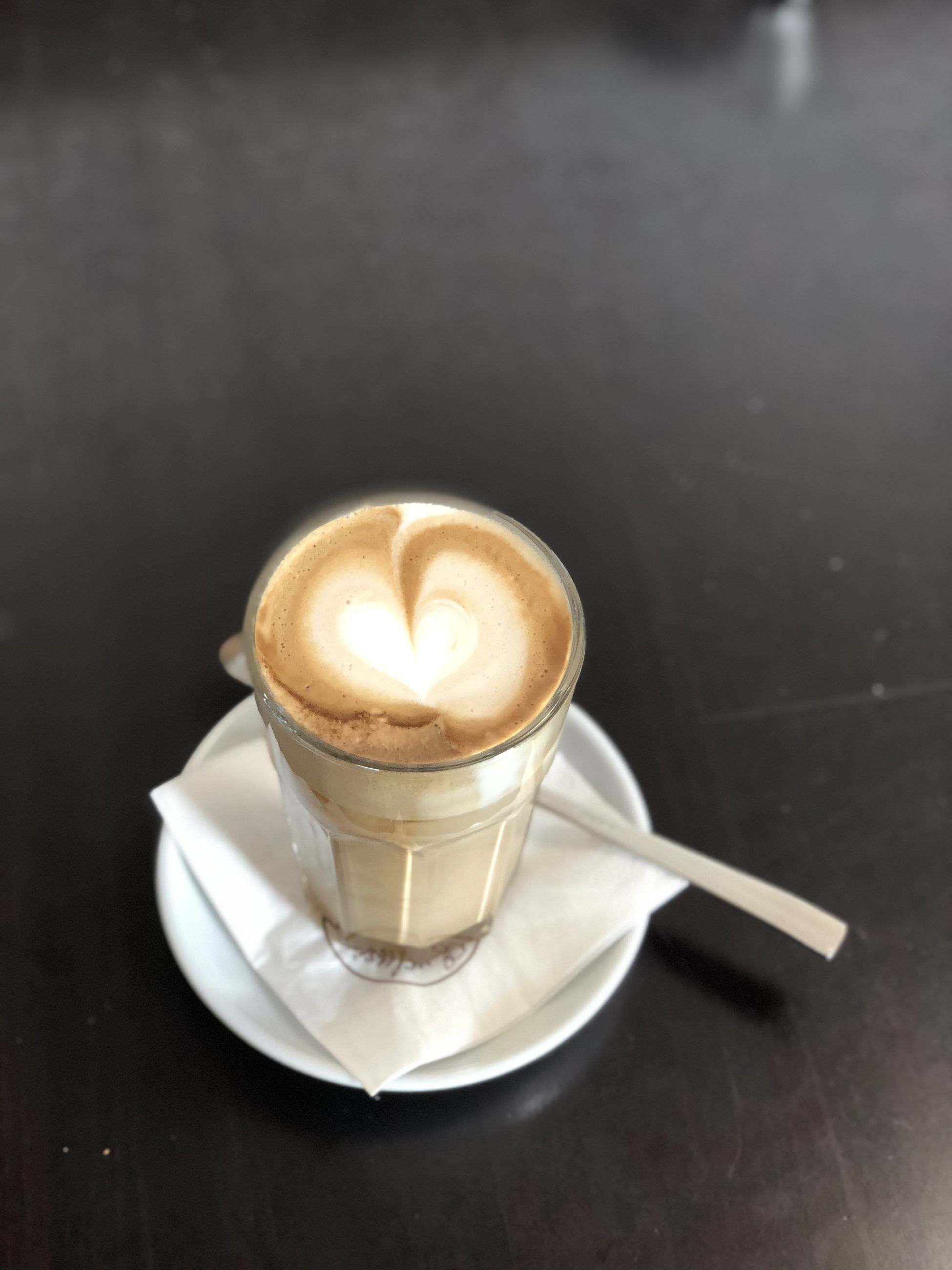 coffee, coffee - drink, refreshment, coffee cup, cup, mug, frothy drink, drink, food and drink, table, crockery, still life, spoon, eating utensil, hot drink, kitchen utensil, cappuccino, saucer, no people, indoors, latte, non-alcoholic beverage, teaspoon