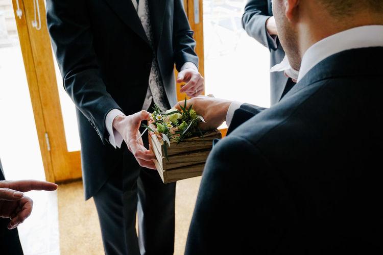Midsection Of Businessmen Having Salads
