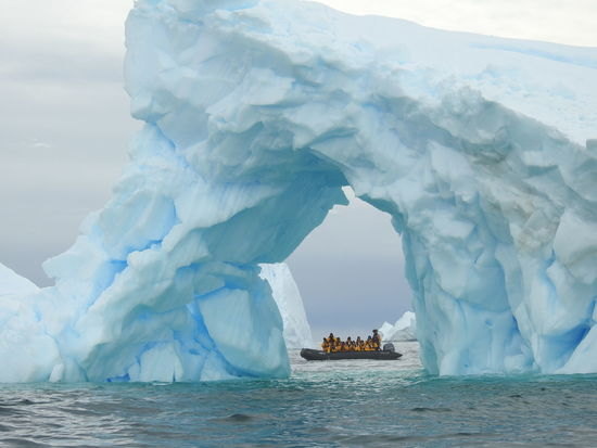Zodiac boat through iceberg formation in the antarctic peninsula Antarctic Peninsula Antartida Blue Iceberg Boat Iceberg Iceberg - Ice Formation Nautical Vessel Outdoors People In The Background Sea Tourism Travel Destinations Zodiac Boat