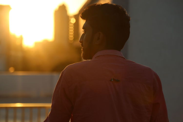 One Person Rear View Men Real People Sunset Lifestyles Focus On Foreground Headshot Casual Clothing Architecture Portrait Sky Young Adult Young Men Standing Built Structure Looking Adult Leisure Activity Looking At View The Art Of Street Photography Exploring Fun My Best Photo