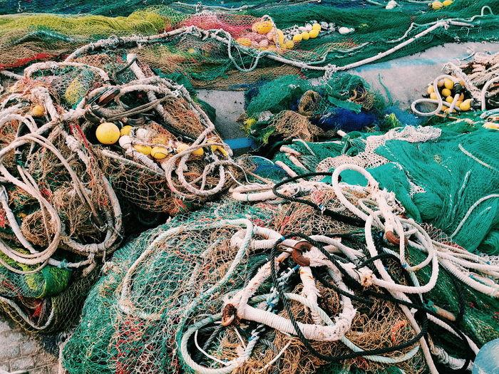 Vibrant fishing net at harbor