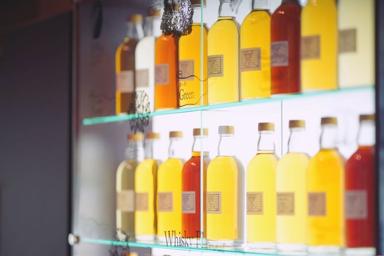 Close-up of bottles in shelf at store