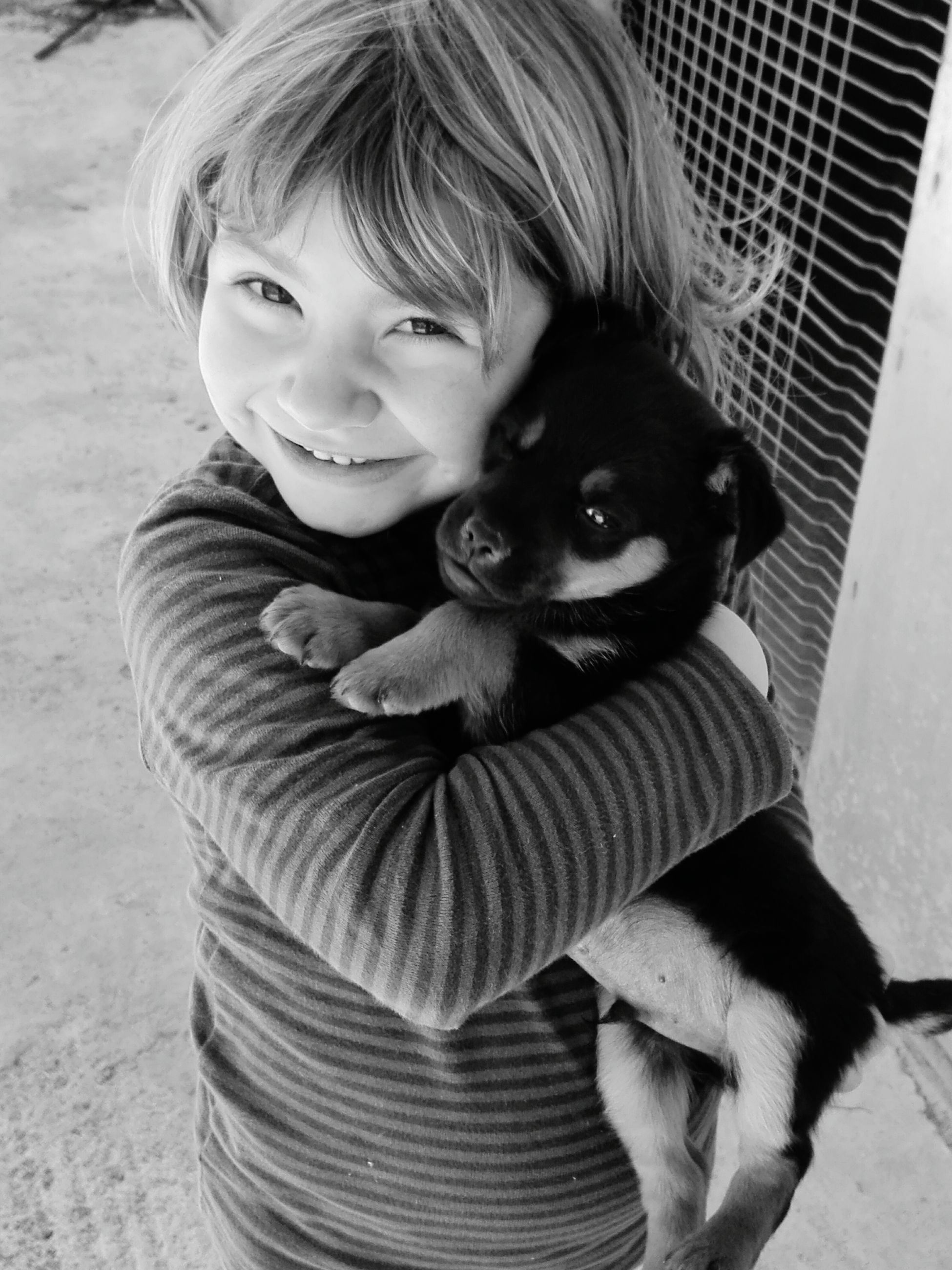 love, innocence, portrait, smiling, one animal, childhood, embracing, happiness, domestic animals, lifestyles, pets, animal themes, real people, one person, cheerful, day, mammal, close-up, people, outdoors, hugging