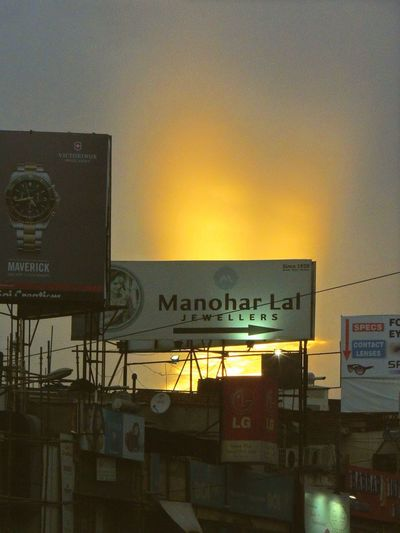 Was amazed at the brilliance of the sunset behind this hoarding.... Street Photography Sunset Brilliance  Like Fire