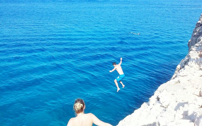 Cliff Diving Rocks And Water Rocks Cliff Adventure Island Cliff Jumping Sea People Woman In Bikini Looking At The Sea Summer Fun Jumping Blue Cyprus Adventure Club
