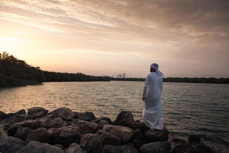 Sunset Mangroves Forest Mangroves Abu Dhabi United Arab Emirates Arab Water Sky Sunset Real People Beauty In Nature Rear View Standing Nature Scenics - Nature One Person Cloud - Sky Men Rock Tranquility