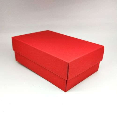High angle view of red box against white background