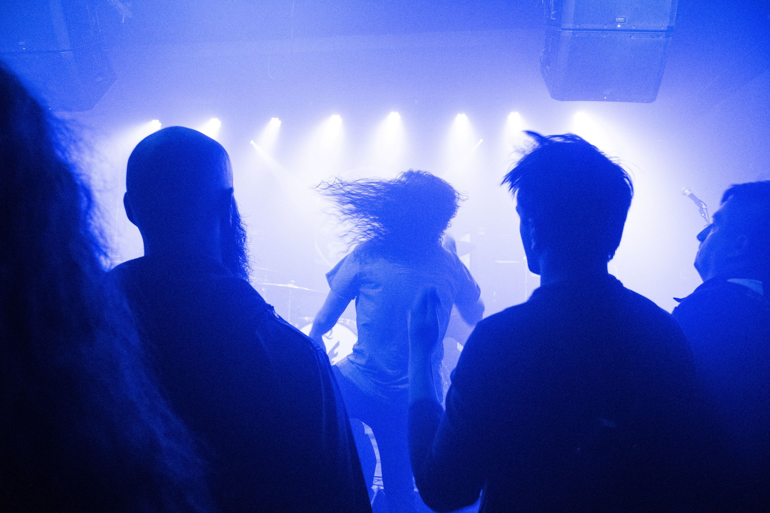 nightlife, togetherness, real people, enjoyment, blue, fun, arts culture and entertainment, men, silhouette, night, excitement, indoors, illuminated, crowd, leisure activity, nightclub, music, performance, women, youth culture, audience, popular music concert, friendship, musician, people