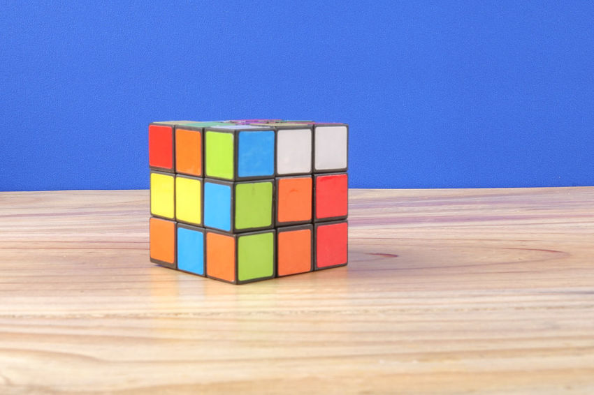 RUBIK'S CUBE , CREATIVITY TOY Creativity Rubik Cube Balance Block Blue Close-up Copy Space Cube Shape Indoors  Intelligence Large Group Of Objects Multi Colored No People Rubik Shape Stack Still Life Studio Shot Table Toy Toy Block Variation Wall - Building Feature Wood - Material
