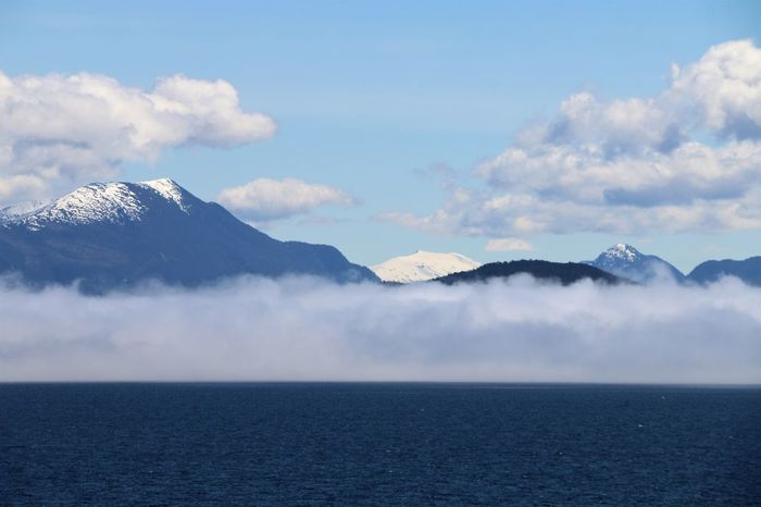 Fog bank in Alaska Fog Bank Alaska Beauty In Nature Cloud - Sky Day Fog Fog Over Water Idyllic Mountain Mountain Range Nature No People Outdoors Scenics Sea Sky Tranquil Scene Tranquility Water