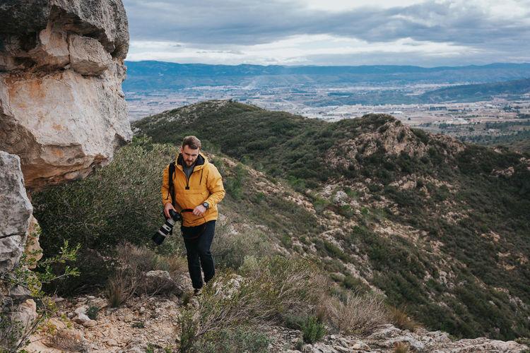 Full length of man walking on mountain