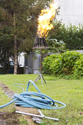 torch burner for draining and cleaning propane tanks in city street , flow flare Propane Propane Tank Propane Burner Gas Gas Tank Propane Draining Drainage Drain Flame Flames Cleaning Maintenance Maintenance Work Butane Burning Burning Propane Industrial Industrial Equipment Service Professional
