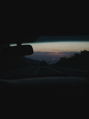 Car Transportation Mode Of Transport Land Vehicle Road Car Interior The Way Forward Car Point Of View Windshield Journey Road Trip Sunset No People Driving Scenics Silhouette Nature Sky Illuminated Outdoors
