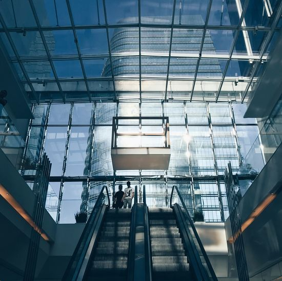 Glass - Material Architecture Built Structure Group Of People Real People Modern Indoors  Men Transparent Day Adult Women Lifestyles Reflection Travel People Escalator Building Incidental People City Ceiling