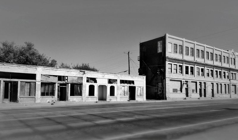 Window Shopping in the Panhandle of Texas - 10/2017 Architecture Outdoors Built Structure City Business Finance And Industry No People Building Exterior Day Sky Politics And Government Smalltown Texas Abandoned Buildings Blackandwhite Blackandwhite Photography EyeEm Best Shots EyeEm Best Edits Eyeembestshots - Black + White Photooftheday Road Trip From A Moving Vehicle Black And White Friday