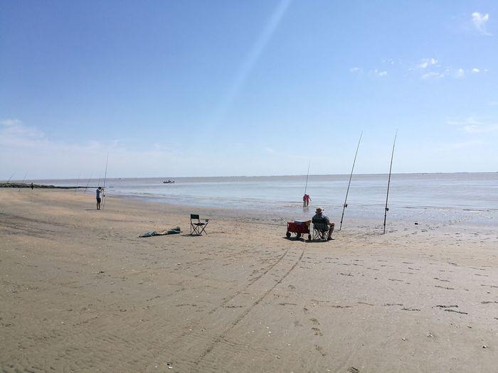 Water Full Length Sea Beach Sitting Headwear Sand Blue Low Tide Sky