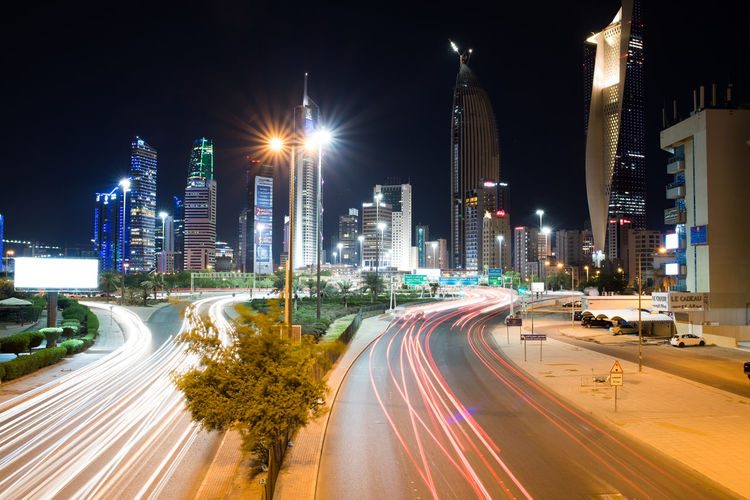Kuwait Kuwait City Architecture Blurred Motion Building Exterior Built Structure City City Life Cityscape High Street Illuminated Light Trail Long Exposure Motion Night No People Outdoors Road Sky Skyscraper Speed Street Street Light Transportation Urban Scene