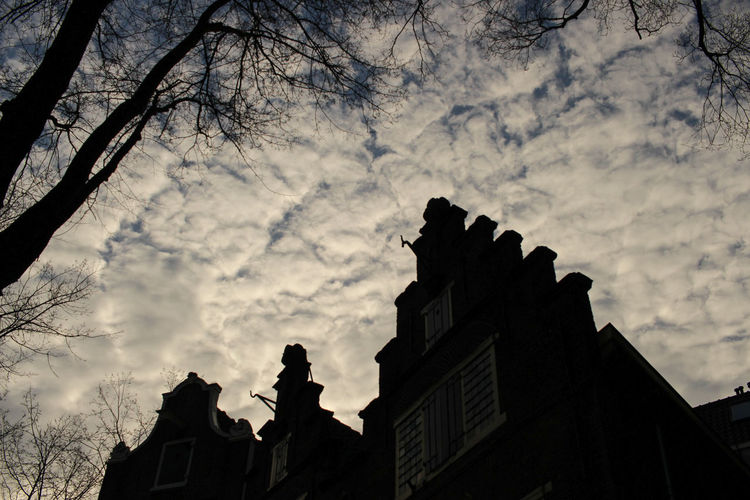 Amsterdam at dusk Amsterdam Netherlands Amsterdamcity Architecture City Cloud - Sky Day Daylight Dusk Dusk In The City Low Angle View Shadow Silhouette Sky Sunset